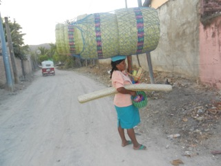 Rural woman carrying goods for sale